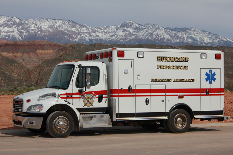 ambulance with snowy mountain background
